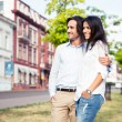 Smiling couple standing outdoors — Stock Photo #77269540