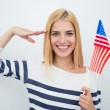 Patriotic woman holding USA flag — Stock Photo #77305736