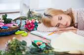 Tired fashion deisgner sleeping on the table — Stock Photo
