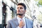 Businessman straightens his tie — Stock Photo
