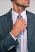Businessman straightening his tie — Stock Photo