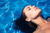 Woman in the swimming pool — Stock Photo