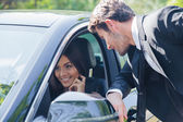 Man talking with woman in car — Stock Photo