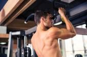 Man tightening on horizontal bar — Stock Photo