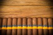 Cigars on rustic table — Foto Stock