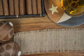 Cigars and Rum or alcohol on table — Stock Photo