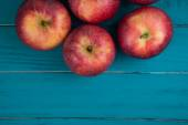 Farm fresh organic red autumn apples on wooden retro blue table — Stock Photo