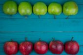 Farm fresh organic red and green apples on wooden table in paste — Stock Photo