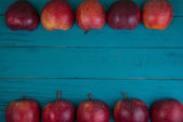 Farm fresh organic red  apples on wooden table in pastel color w — Foto de Stock
