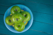 Farm fresh organic green apples on wooden retro blue table in ba — Stock Photo