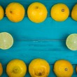 Fresh organic lemons on wooden background — Stock Photo #54196797