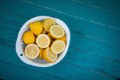 Fresh organic lemons halves on table — Stock Photo