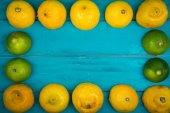 Fresh organic lemons on wooden background — Foto de Stock
