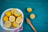 Organic lemons and juice squeezer on table — Stock Photo