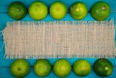Fresh organic limes on wooden background — Foto de Stock