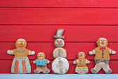 Happy Snowman and gingerbread man family — Stock Photo