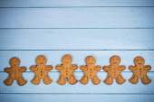 Gingerbread man on wooden background — Stock Photo