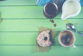 Fresh donut with coffee and milk for breakfast — Stock Photo