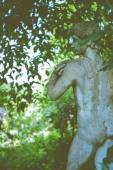 Nude male sculpture in garden — Stock Photo