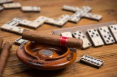 Cuban cigar on table with domino game — Stock Photo