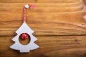 Christmas tree decor hang on wood — Stock Photo
