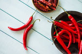 DFresh and dried red peppers on white table — Stock Photo