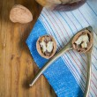 Table top view on nut cracker and open walnut — Stock Photo #58165551