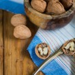 Table top view on nut cracker and open walnut — Stock Photo #58165577