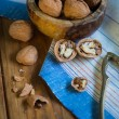 Table top view on nut cracker and open walnut — Stock Photo #58165627