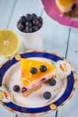 Fresh lemon and blueberry cake on plate — Photo