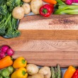 Fresh veegetables and chopping board — Stock Photo #58809607