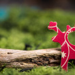 Wooden toy retro reindeer on natural moss with copy space backgr — Stock Photo #59156079
