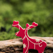 Wooden toy retro reindeer on natural moss with copy space backgr — Stock Photo #59156099