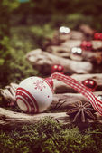 Christmas vintage ball decoration on natural moss and wood — Stock Photo
