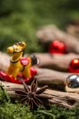Vintage Christmas decorations on wood and natural moss — Stock fotografie