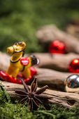 Vintage Christmas decorations on wood and natural moss — Stockfoto