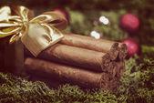 Cuban cigars Christmas gift with ribbon and ornaments — Stock Photo