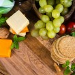 Wooden board with oat cakes and cheese — Stock Photo #60770165