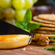 Close view on cheese with oat cakes and walnut on board — Stock Photo #60776341