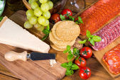 Overhead vie on parmesan cheese with other snacks — Stock Photo