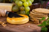 Traditional  english apricot soft cheese with oat crackers — Stock Photo
