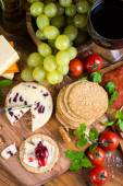 Traditional english soft cheese with cranberry sauce — Stock Photo