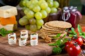 Selection of soft cheese with fruits, spices and meat — Stock Photo