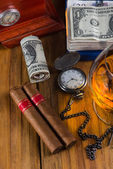 Wealthy man desk, cuban cigars dollar notes, vintage watch and a — Stock Photo
