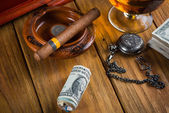 Relaxing cuban cigar after hard day, with glass of Rum — Stock Photo