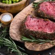 Top view on raw steak with herbs and pepper — Stock Photo #63978369