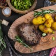 Beef steak with roasted potatoes and herbs, top view — Stock Photo #63979865