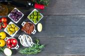 Selection of spanish tapas with red wine from above — Stock Photo