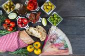 Spanish tapas on wooden rustic table from above — Stock Photo