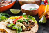 Close view on mexina tacos with beef and vegetables — Stock Photo